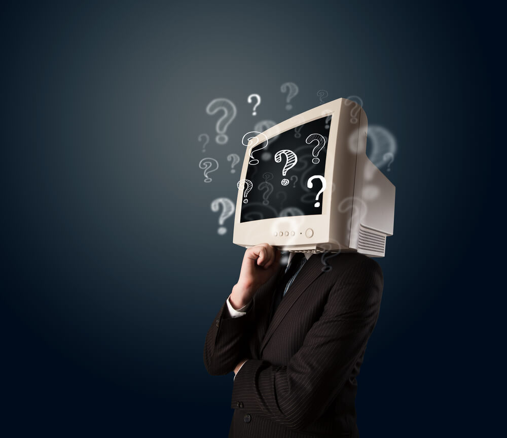 Business man with computer monitor as head asking questions about web design